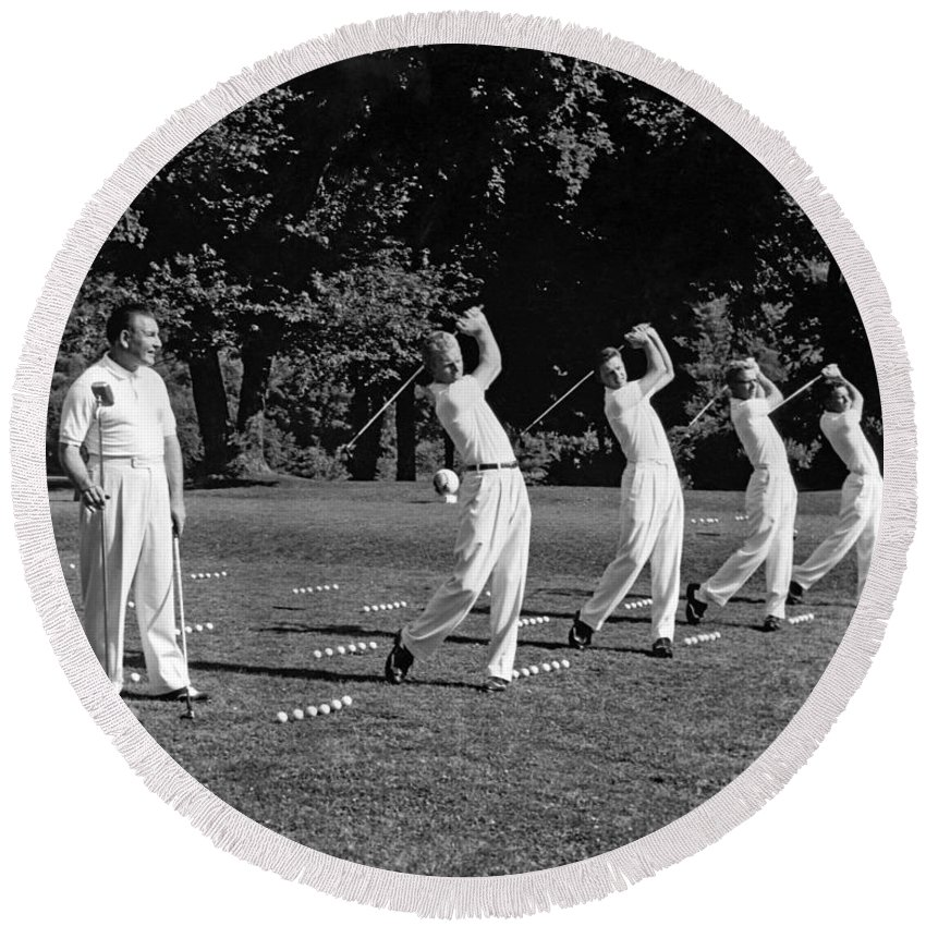 1950s Round Beach Towel featuring the photograph A Golf Driving Demonstration. by Underwood Archives