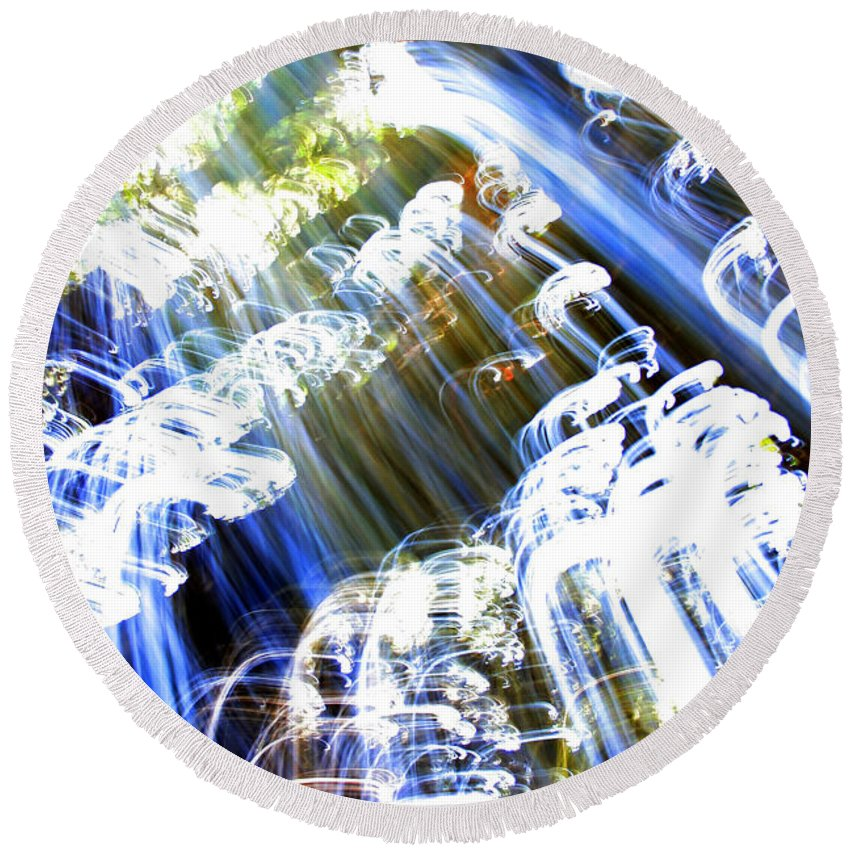 Black Round Beach Towel featuring the photograph A Light Waterfall by Ric Bascobert