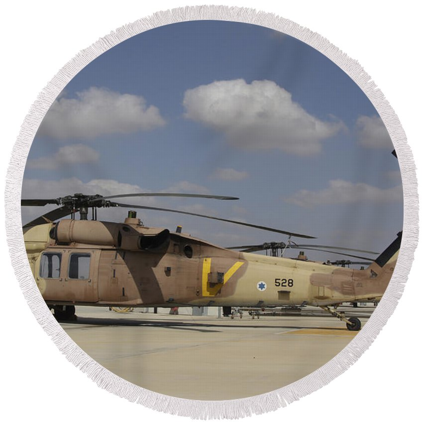 Transportation Round Beach Towel featuring the photograph A Line Of Uh-60l Yanshuf Helicopters by Ofer Zidon