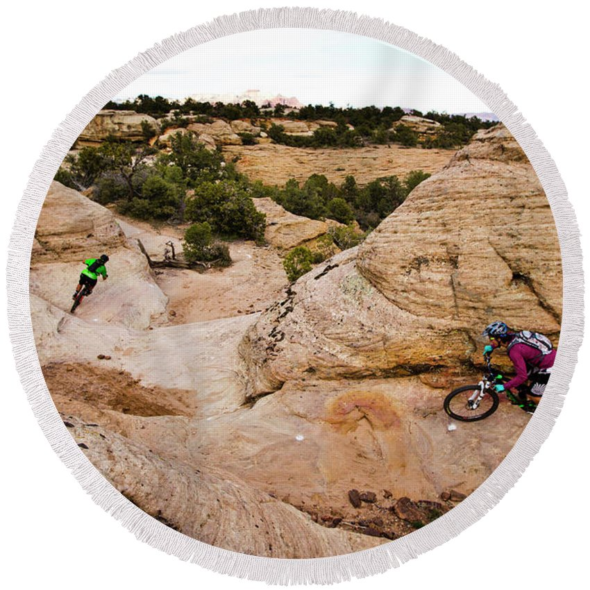 Adventure Round Beach Towel featuring the photograph A Male And Female Mountain Biker Ride by Dan Barham