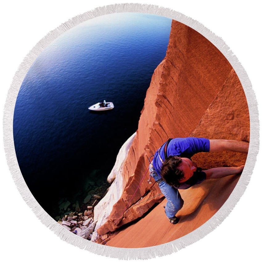 Boat Round Beach Towel featuring the photograph A Man Rock Climbing by Corey Rich