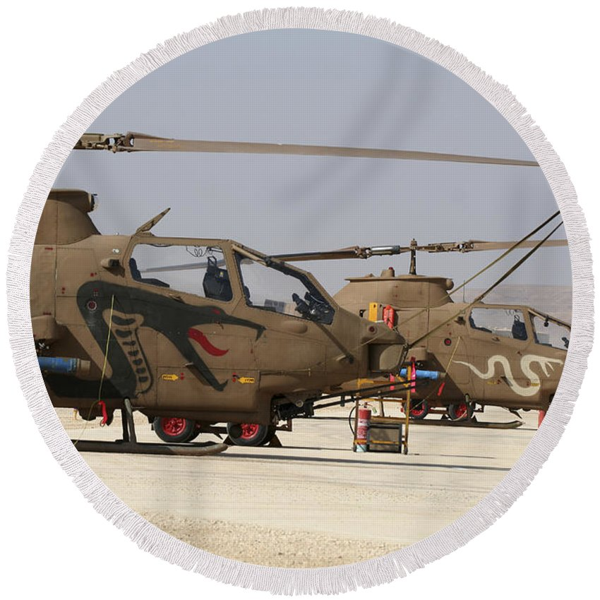 Aircraft Round Beach Towel featuring the photograph A Pair Of Ah-1s Tzefa Attack by Ofer Zidon