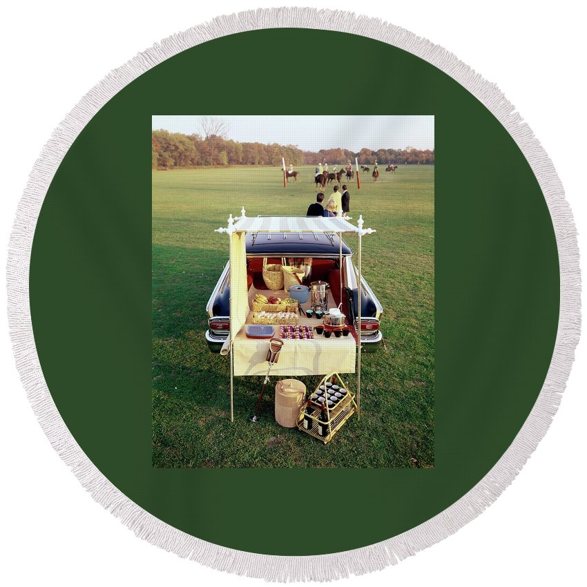 Food Round Beach Towel featuring the photograph A Picnic Table Set Up On The Back Of A Car by Rudy Muller