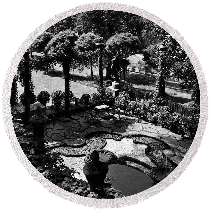 Garden Round Beach Towel featuring the photograph A Pond In An Ornamental Garden by Gottscho-Schleisner