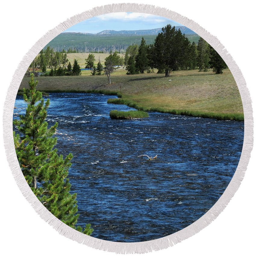 Yellowstone National Park Round Beach Towel featuring the photograph A River Runs Through Yellowstone by Laurel Powell