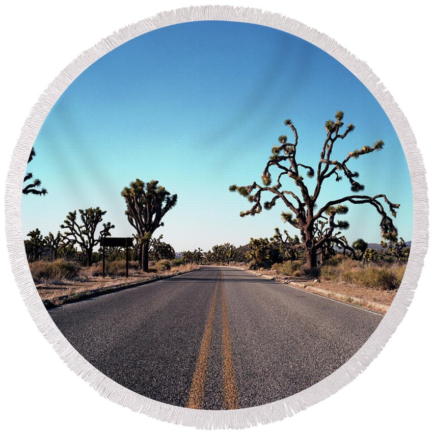 California Round Beach Towel featuring the photograph A Road Leads Through Joshua National by Todd Korol