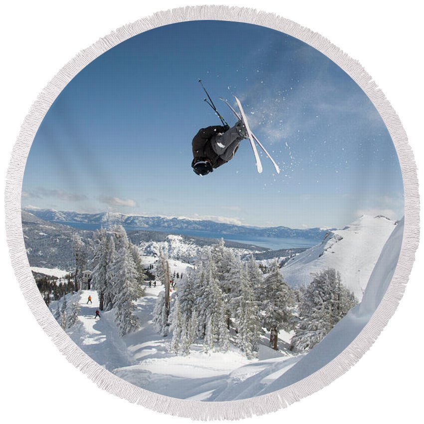 25-29 Years Round Beach Towel featuring the photograph A Skier Doing A Front Flip Into Powder by Venture Media Group