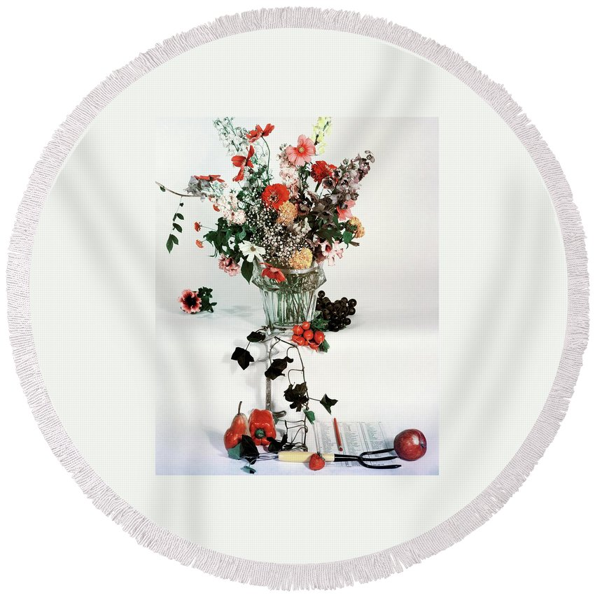 Nobody Round Beach Towel featuring the photograph A Studio Shot Of A Vase Of Flowers And A Garden by Herbert Matter