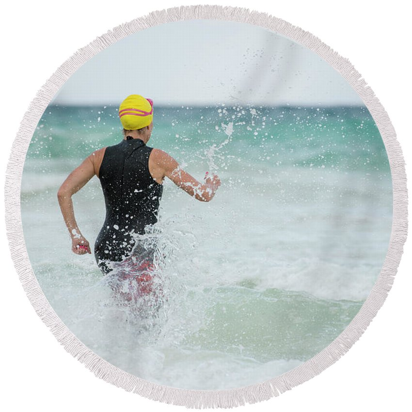 Activity Round Beach Towel featuring the photograph A Swimmer Running To The Ocean by Marcos Ferro