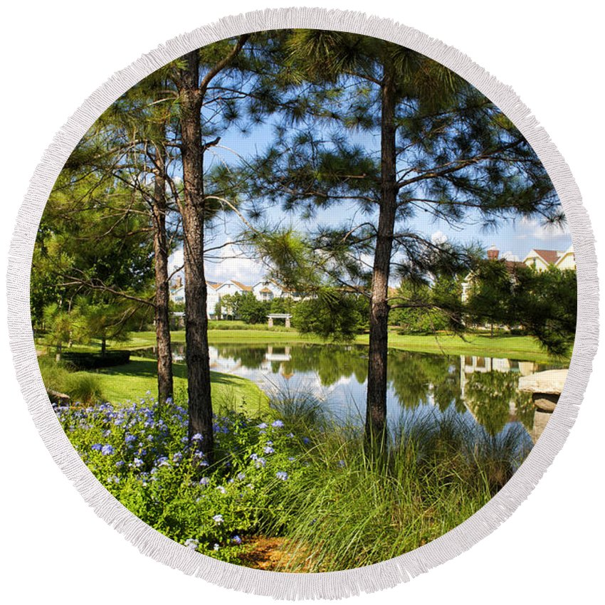 Pond Round Beach Towel featuring the photograph A Tranquil Pond At Walt Disney World by Thomas Woolworth