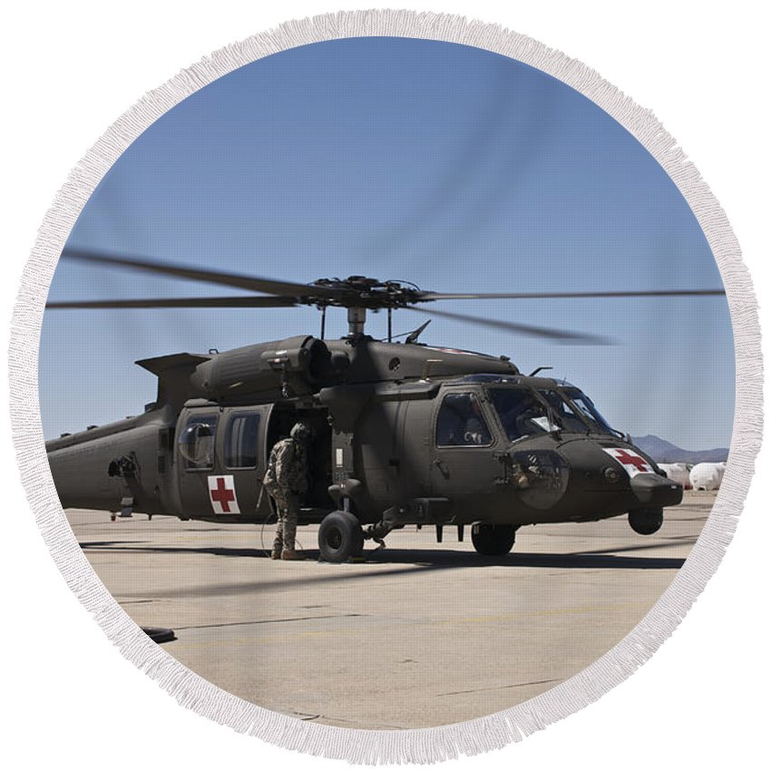 Exercise Angel Thunder Round Beach Towel featuring the photograph A Uh-60 Blackhawk Helicopter by Terry Moore