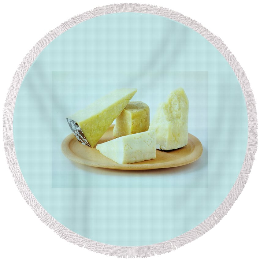 Dairy Round Beach Towel featuring the photograph A Variety Of Cheese On A Plate by Romulo Yanes