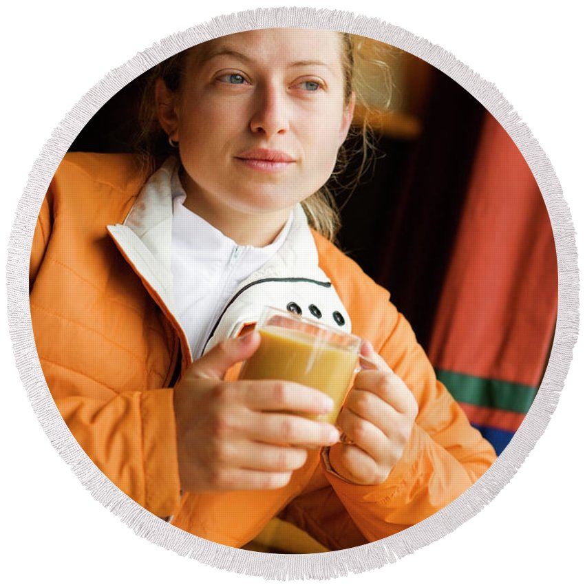 Caucasian Appearance Round Beach Towel featuring the photograph A Woman Enjoys A Warm Cup Of Cocoa by Ty Milford