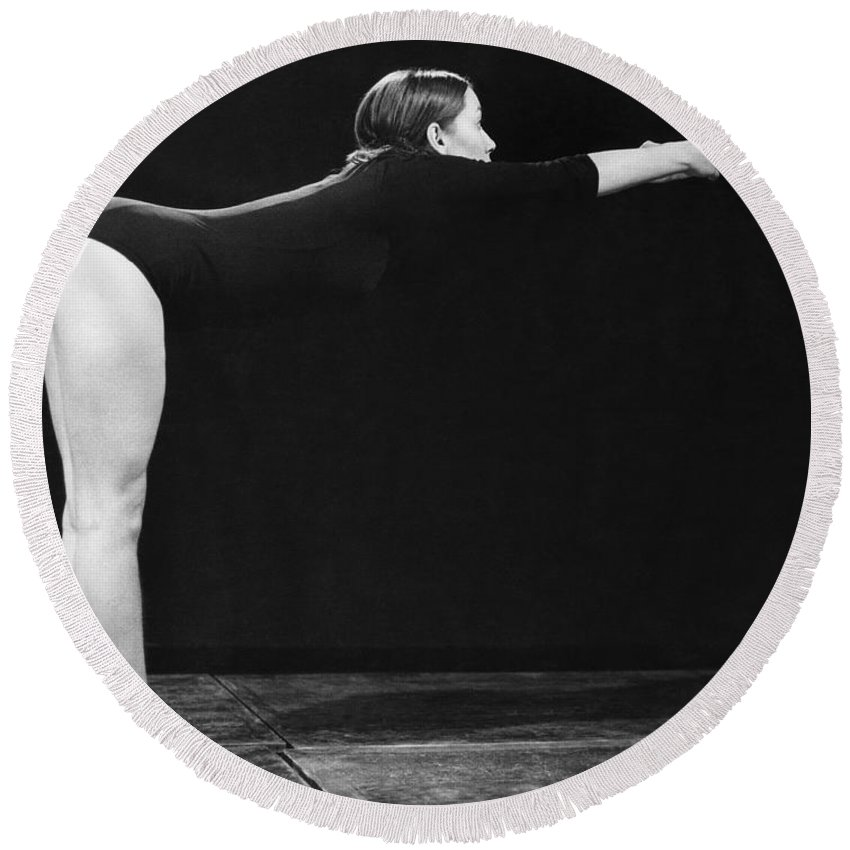 1 Person Round Beach Towel featuring the photograph A Woman Stretching by Underwood Archives