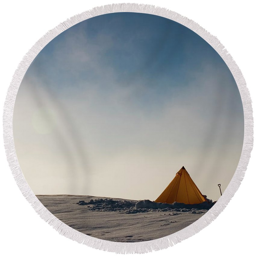 Adventure Round Beach Towel featuring the photograph A Yellow Pyramid Tent In The Snow, Mt by Dan Shugar