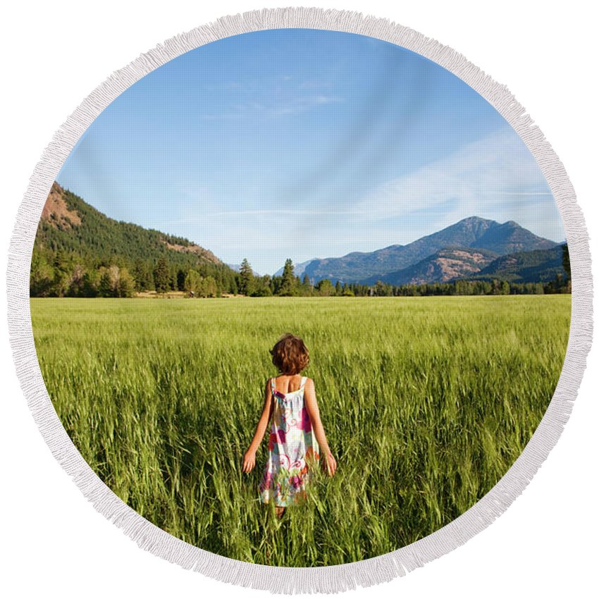 Carefree Round Beach Towel featuring the photograph A Young Girl, Daughter Of A Farmer by Michael Hanson