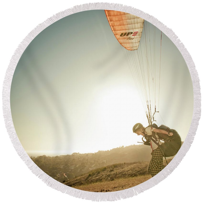 Adult Round Beach Towel featuring the photograph A Young Man Launches His Paraglider by Kevin Steele