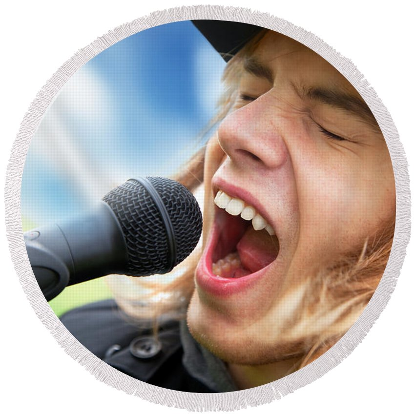 Sing Round Beach Towel featuring the photograph A Young Man Sings To A Microphone by Michal Bednarek