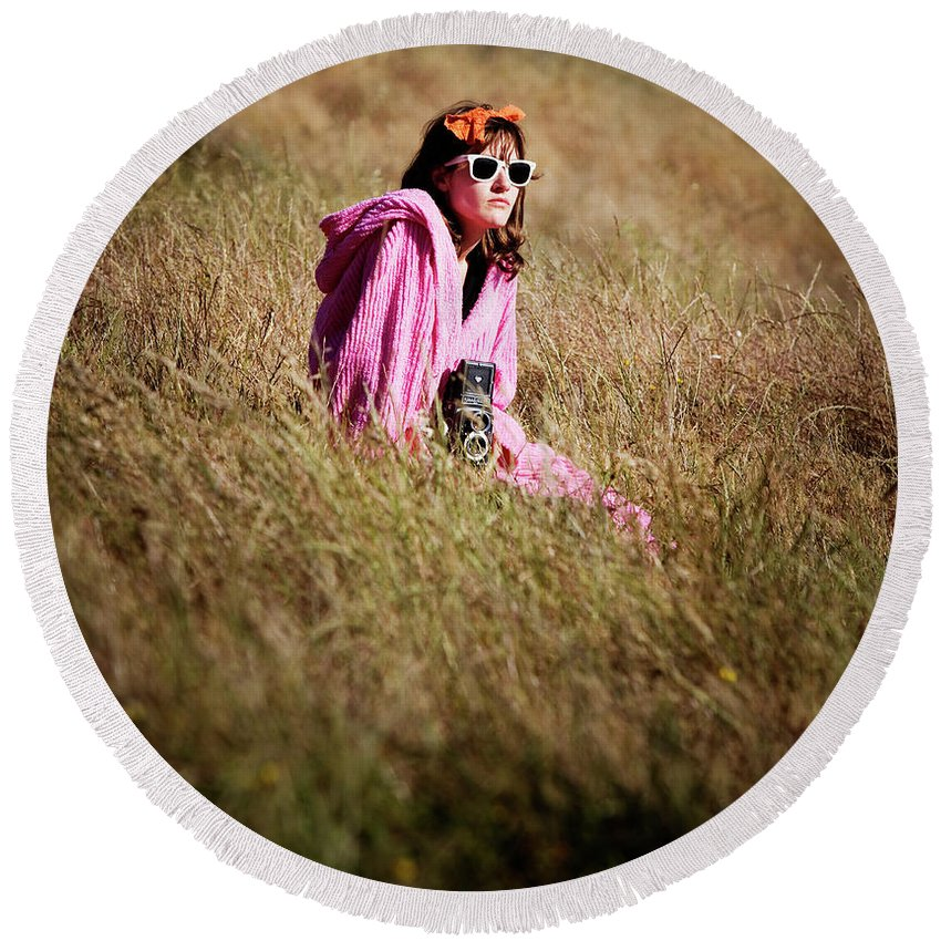 California Round Beach Towel featuring the photograph A Young Woman Sitting In A Field by Ron Koeberer