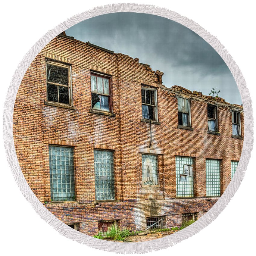 Old Round Beach Towel featuring the photograph Abandoned Brick Building by Paul Freidlund