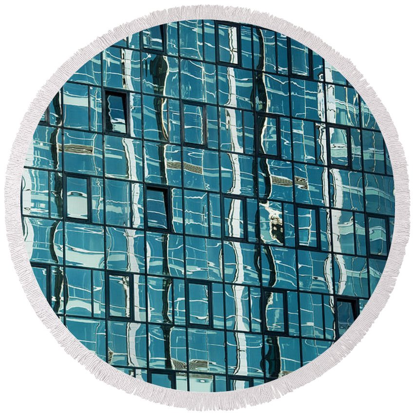 Building Round Beach Towel featuring the photograph Abstract Reflections In Windows by Artur Bogacki