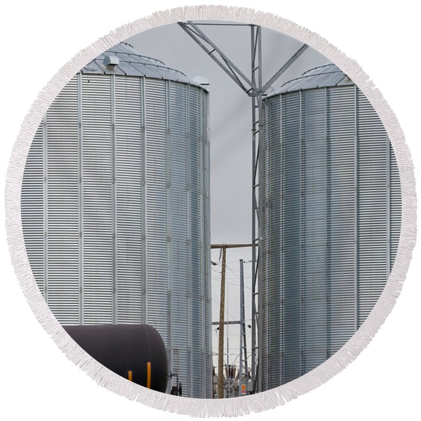 Agribusiness Round Beach Towel featuring the photograph Agricultural Grain Silos Exterior Railway Wagon by Stephan Pietzko