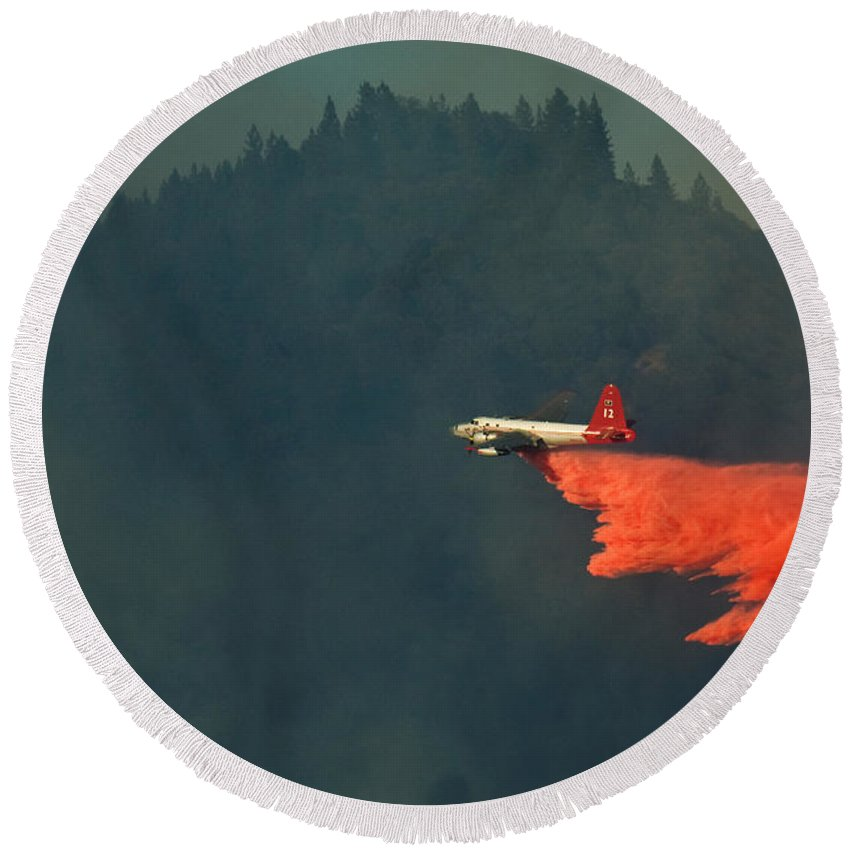 Fire Round Beach Towel featuring the photograph Aircraft Releasing Fire Retardant by Ron Sanford