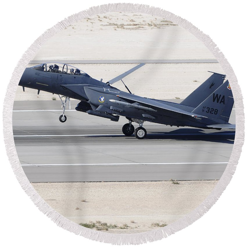 Horizontal Round Beach Towel featuring the photograph An F-15c Eagle Landing On The Runway by Remo Guidi
