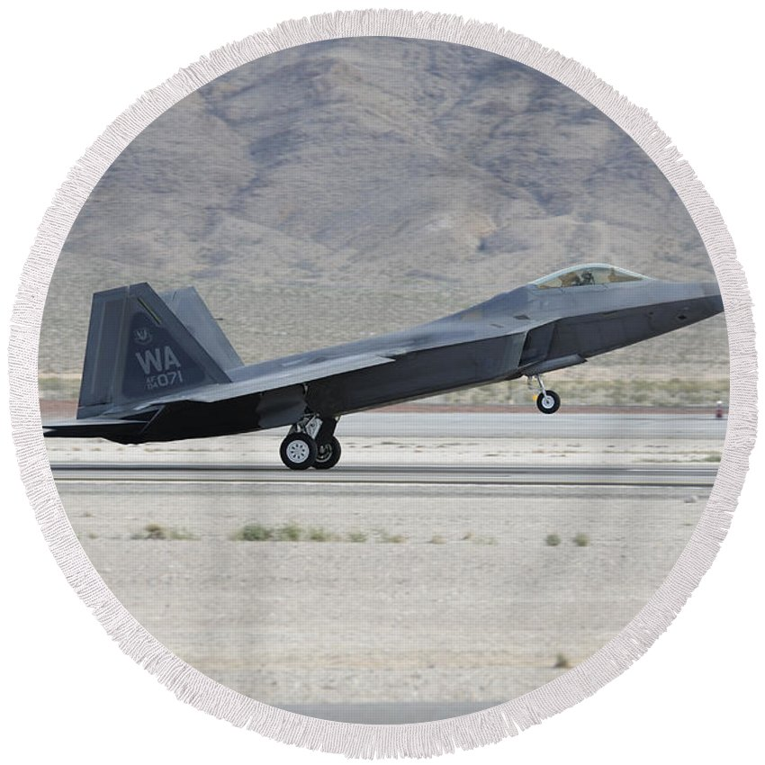 Horizontal Round Beach Towel featuring the photograph An F-22 Raptor Landing On The Runway by Remo Guidi