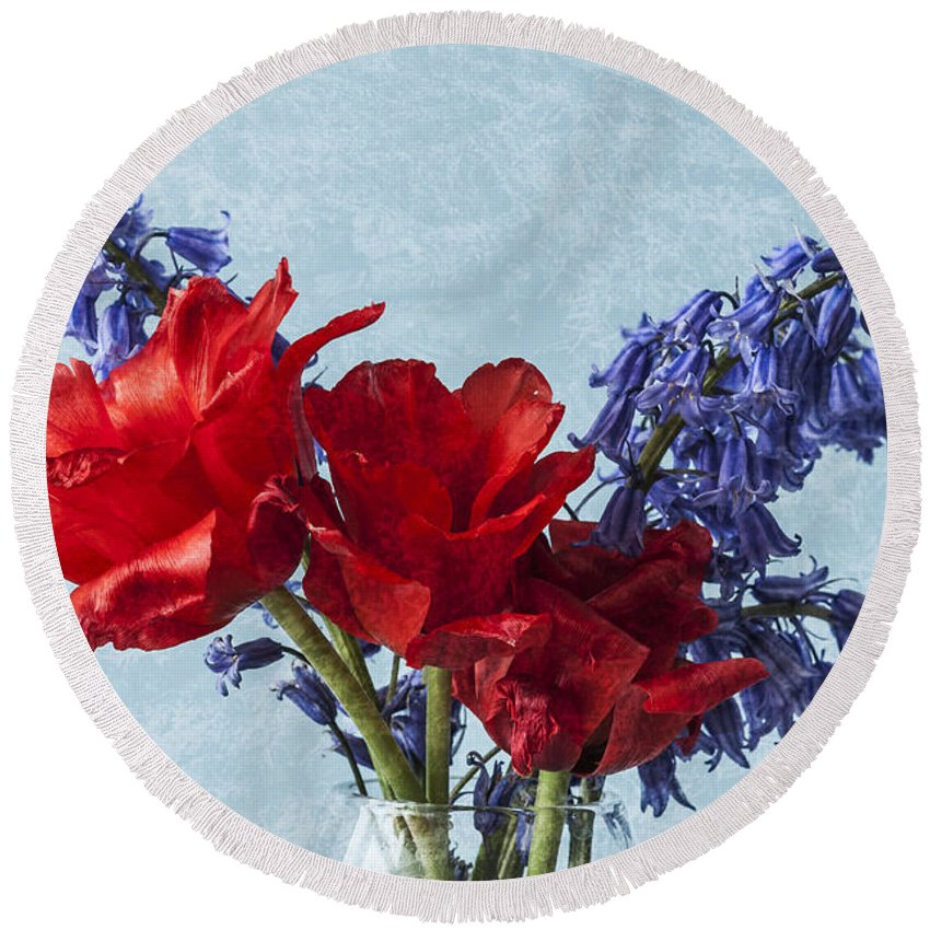 Red Tulips Round Beach Towel featuring the photograph An Unusual Pair by Steve Purnell