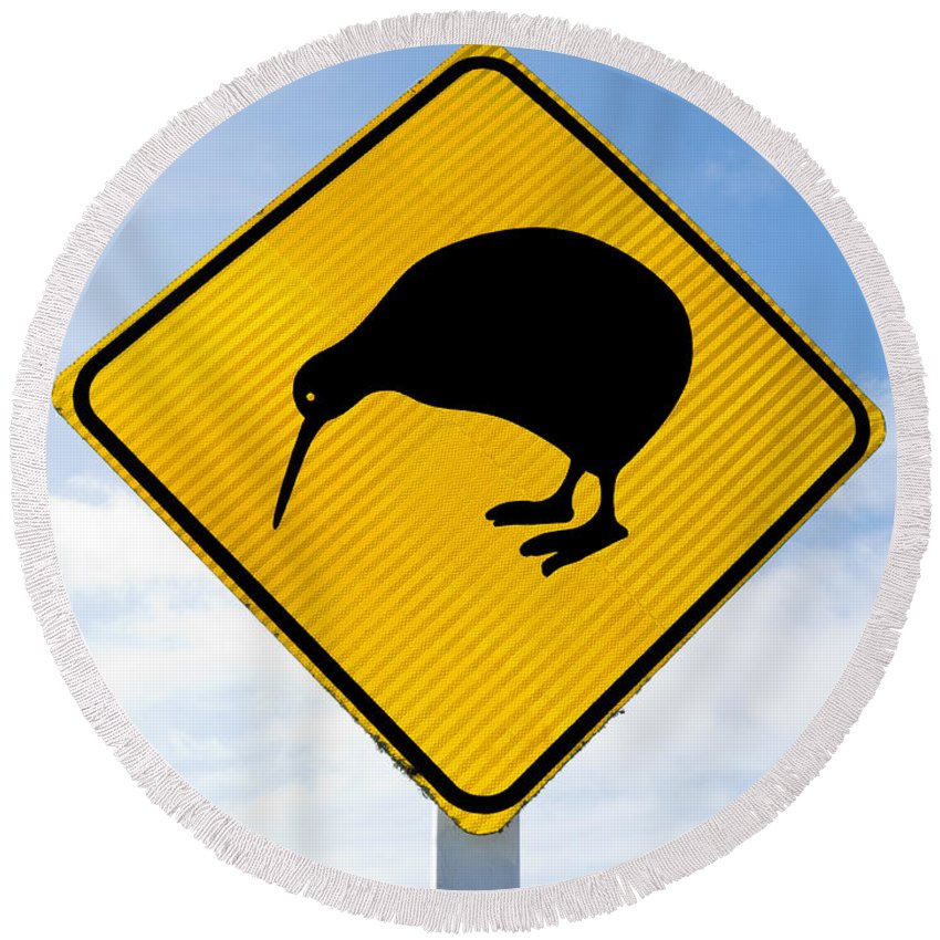 Animal Round Beach Towel featuring the photograph Attention Kiwi Crossing Road Sign by Stephan Pietzko
