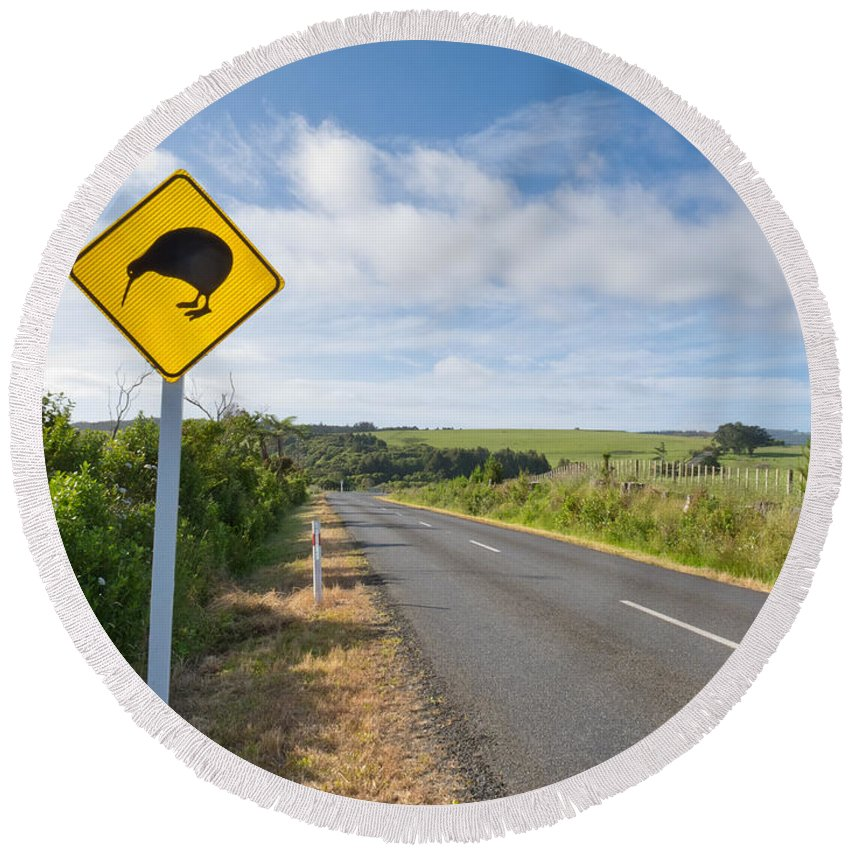 Animal Round Beach Towel featuring the photograph Attention Kiwi Crossing Roadsign At Nz Rural Road by Stephan Pietzko