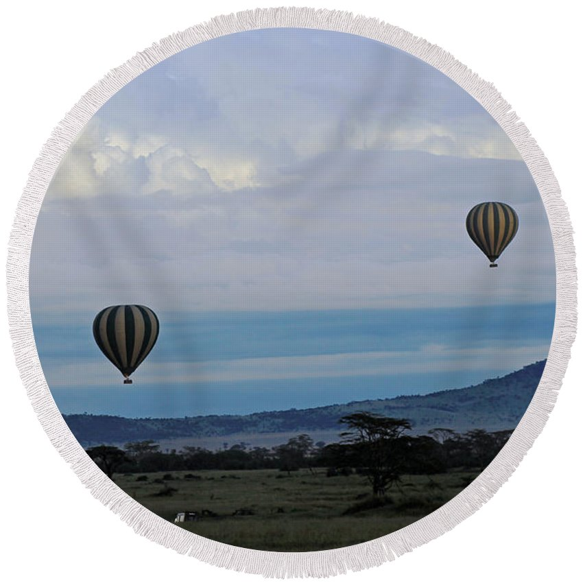 Hot Air Balloons Round Beach Towel featuring the photograph Balloons Above Serengeti. by Tony Murtagh