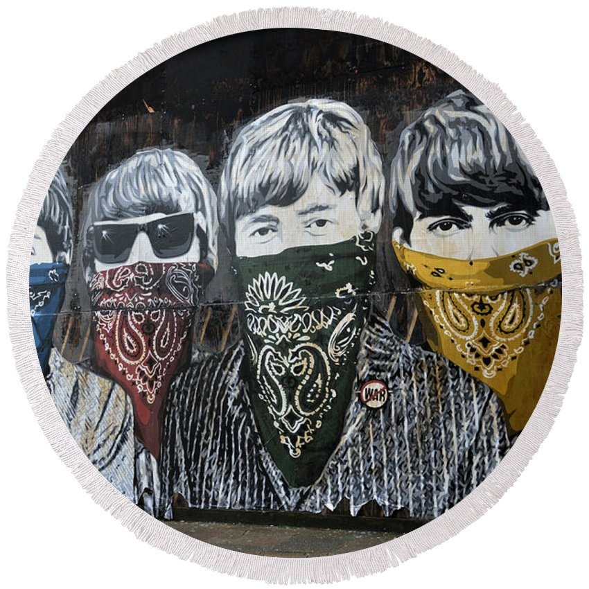 Banksy Round Beach Towel featuring the photograph The Beatles wearing face masks street mural by RicardMN Photography