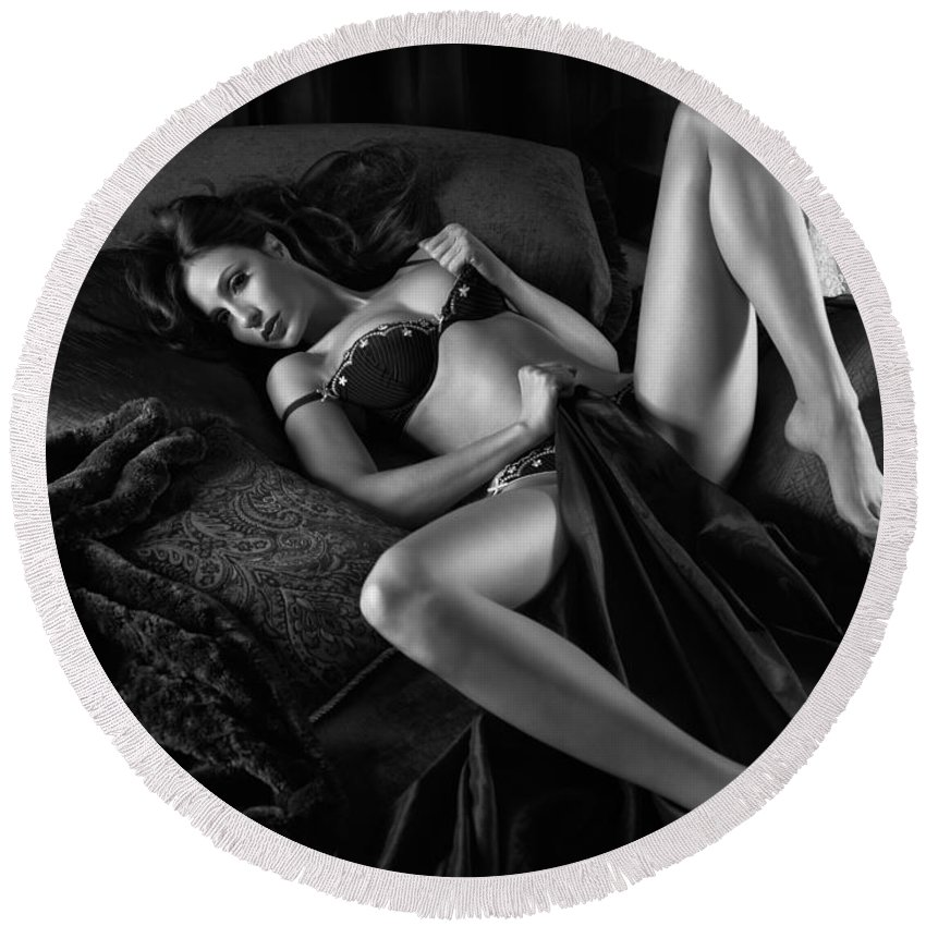 Glamour Round Beach Towel featuring the photograph Beautiful Sexy Woman In Lingerie Lying On Bed Black And White by Maxim Images Prints