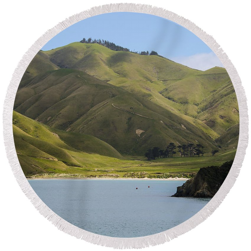 Cook Strait New Zealand Water Grass Grasses Rock Rocks Hill Hillside Hills Hillsides Landscape Landscapes Waterscape Waterscapes Round Beach Towel featuring the photograph Beauty Of Cook Strait by Bob Phillips