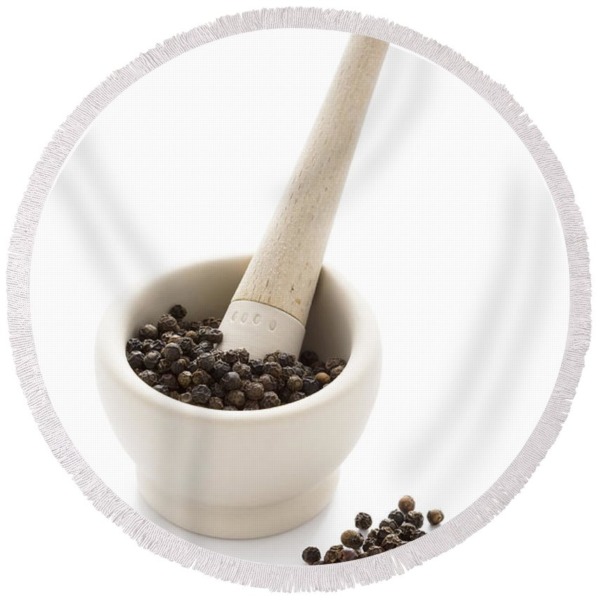 Pestle And Mortar Round Beach Towel featuring the photograph Black Peppercorns In A White Pestle And Mortar by Lee Avison