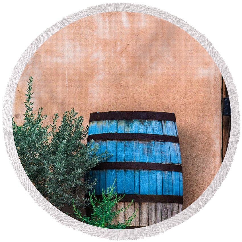 Steven Bateson Round Beach Towel featuring the photograph Blue Barrel With Adobe by Steven Bateson