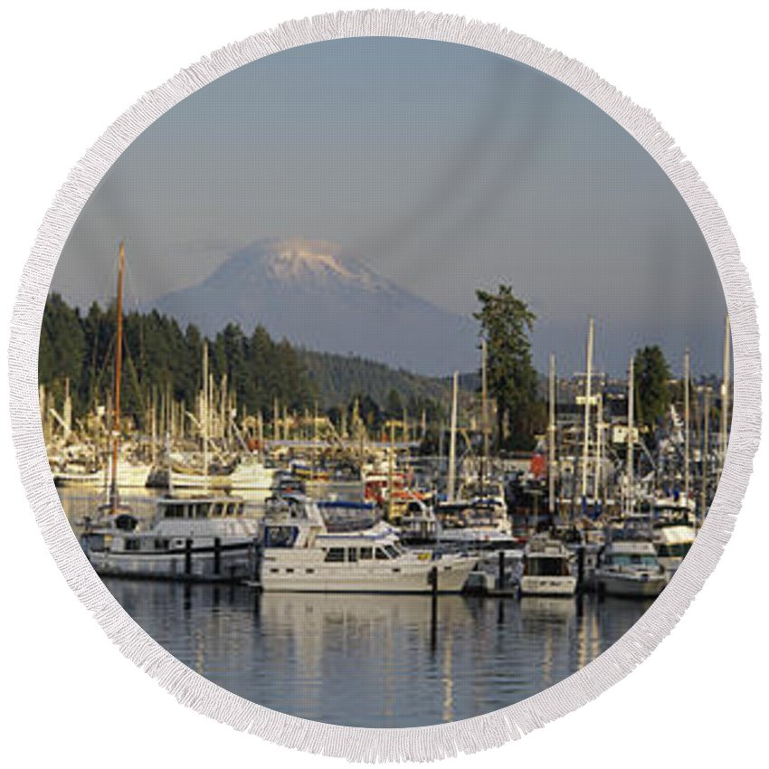 Photography Round Beach Towel featuring the photograph Boats Docked At A Harbor With Mountain by Panoramic Images