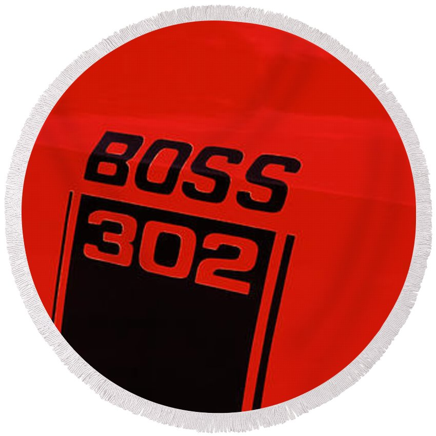 Photography Round Beach Towel featuring the photograph Boss 302 Emblem On A Car by Panoramic Images