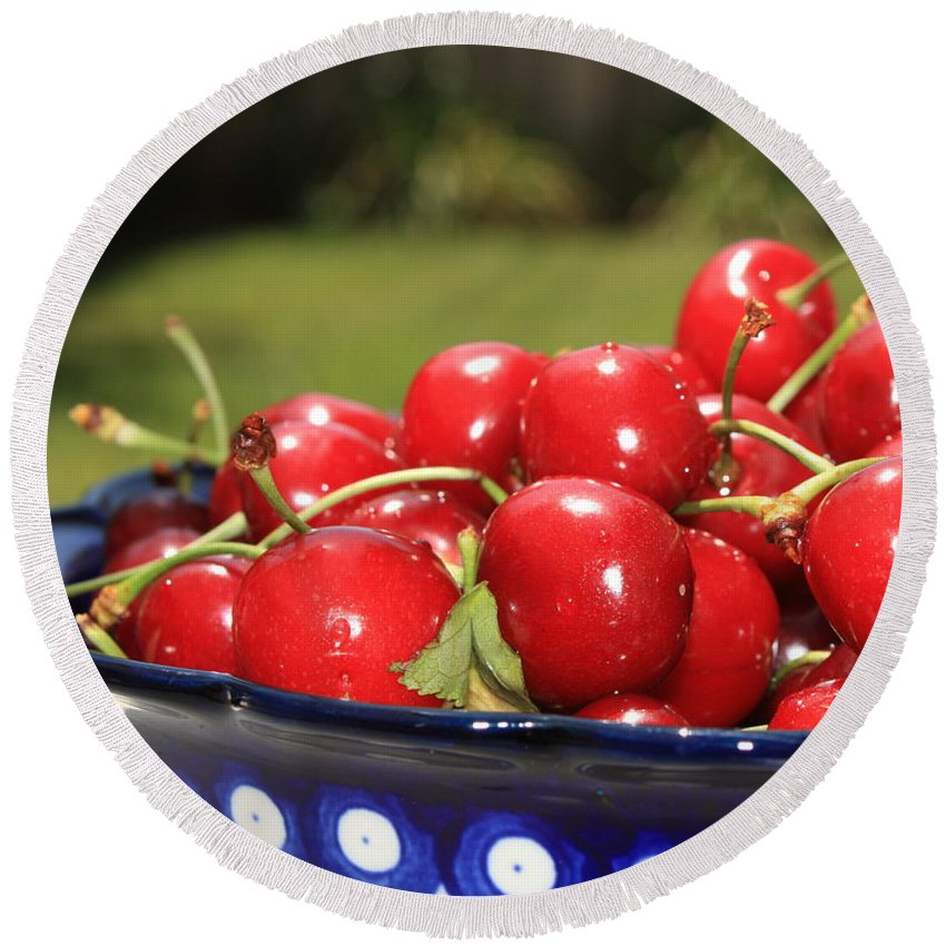 Cherries Round Beach Towel featuring the photograph Bowl Of Cherries In The Garden by Carol Groenen