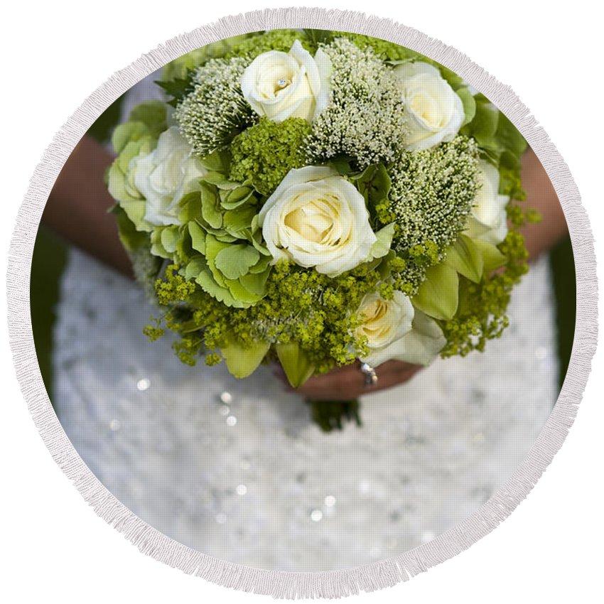 Bouquet Round Beach Towel featuring the photograph Bride Holding A Wedding Bouquet by Lee Avison