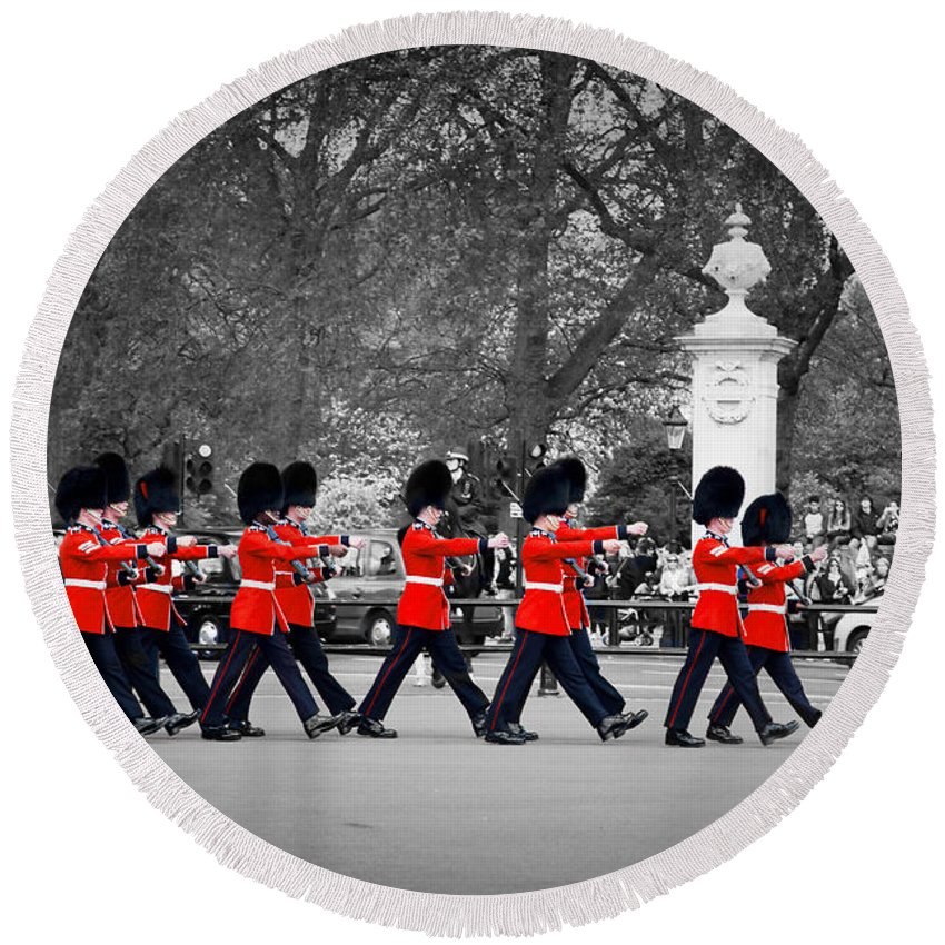 London Round Beach Towel featuring the photograph British Royal Guards March And Perform The Changing Of The Guard In Buckingham Palace by Michal Bednarek