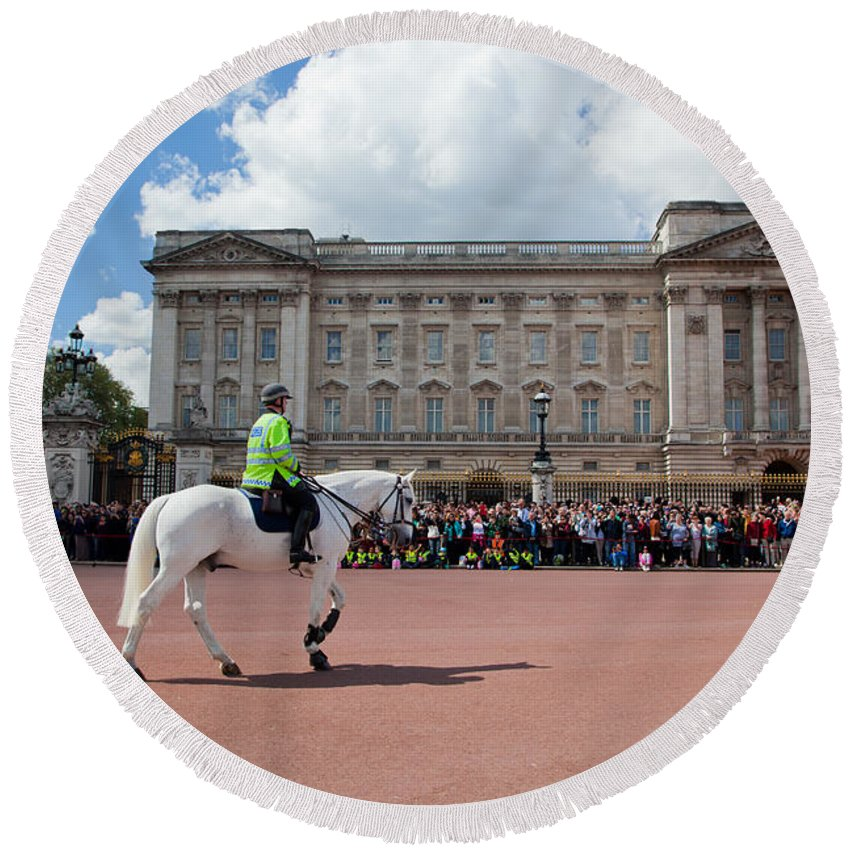 London Round Beach Towel featuring the photograph British Royal Guards Riding On Horse And Perform The Changing Of The Guard In Buckingham Palace by Michal Bednarek
