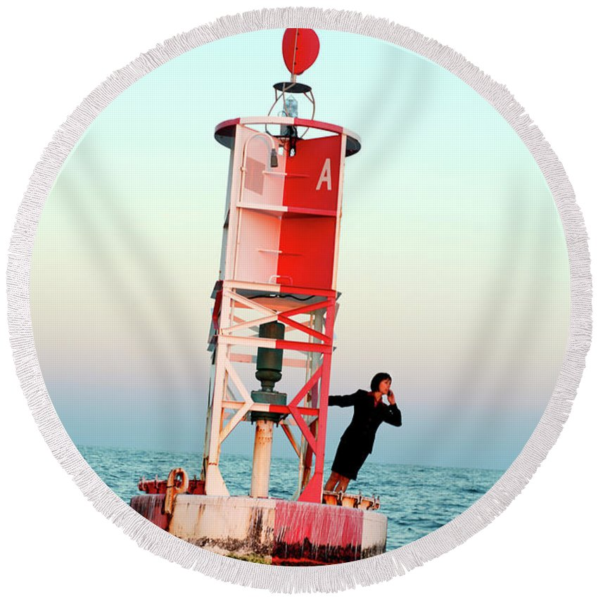 Abandoned Round Beach Towel featuring the photograph Business Woman On A Buoy by Logan Mock-Bunting