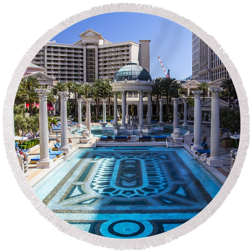 Las Vegas Round Beach Towel featuring the photograph Caesars Pool by Angus Hooper Iii