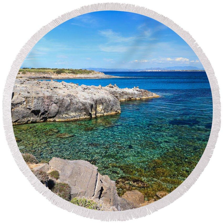 La Bobba Round Beach Towel featuring the photograph Carloforte Coastline by Antonio Scarpi