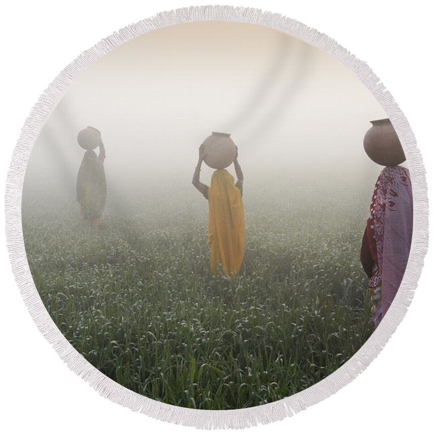 Asia Round Beach Towel featuring the photograph Carrying Water On A Foggy Morn In India by Michele Burgess