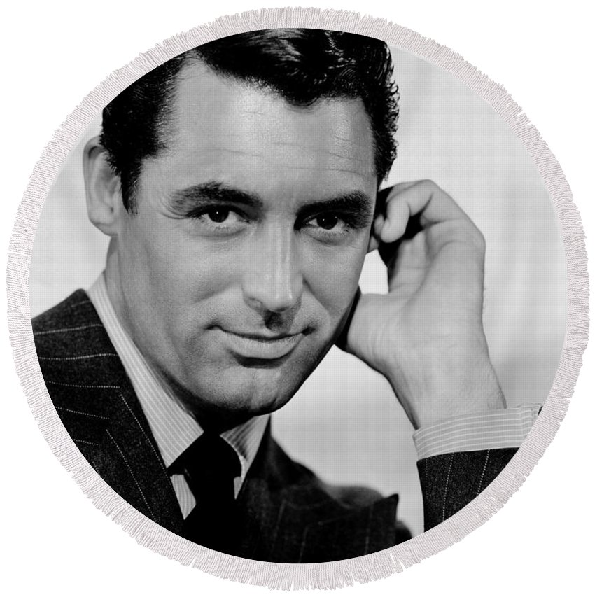 English-american Actor Cary Grant In A Publicity Still For The 1941 Film Suspicion Round Beach Towel featuring the painting Cary Grant by Celestial Images