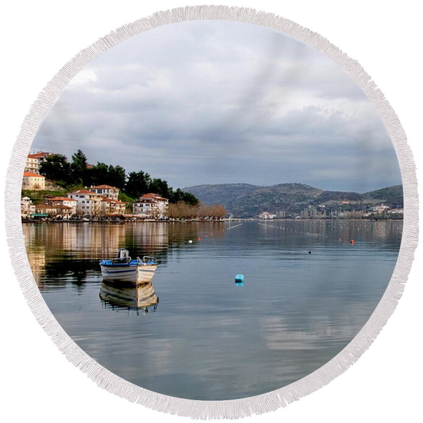 Calm Lake Round Beach Towel featuring the photograph Kastoria Lake In Greece by Michalakis Ppalis